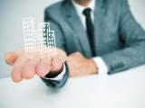 Immeubles virtuels posés sur une main